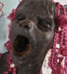 "Fashion Victim #2, 2009, clay, synthetic hair, fake eyelashes, fur, paint, wood, 20"" x 17"" x 10"""