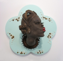 "Fashion Victim #3, 2009, clay, fake eyelashes, fur, paint, fake nails, wood, porcelain, lacquer, 17"" x 17"" x 11"""