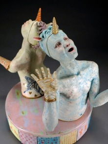 "Back to Back, 2012, stoneware, glaze, underglaze pencil, wood, ribbon, glitter, 17"" x 16"" x 16"""