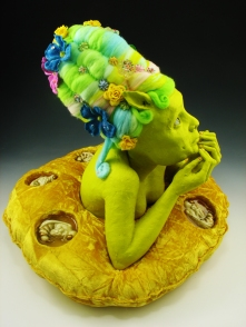 "Not Funny, 2010, terracotta, porcelain, felted wool, paint, resin, fabric, fake flowers, sand, 24"" x 16"" x 16"""