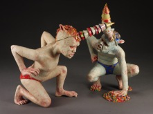 "Party Boys, 2013, stoneware, underglaze, glaze, paint, resin, elastic cord, candy, 12"" x 13"" x 10"""